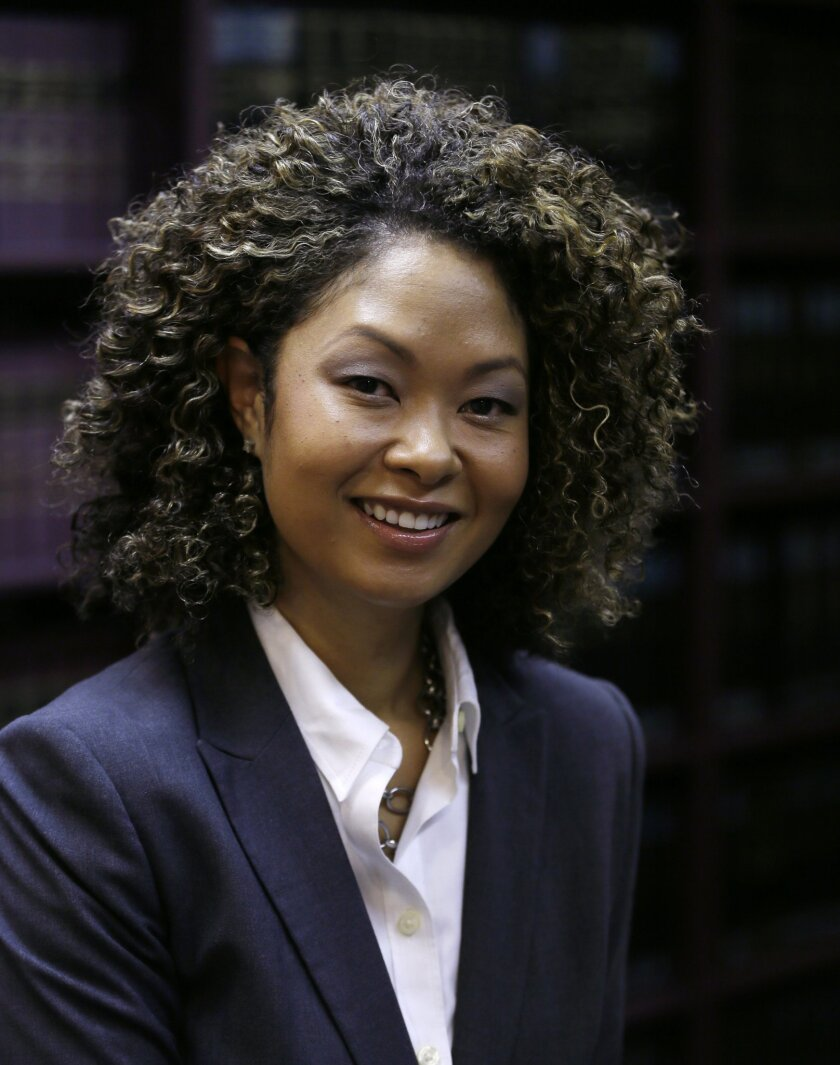 """In this Thursday, Nov. 19, 2015, photo, attorney Naomi Oglesby poses for a photo in her office in Bingham Farms, Mich. Oglesby minored in black studies while a student at the University of Missouri and argues that the field of study remains relevant. """"This curriculum has shaped my perspective, ideology, interpretation of other races and cultures, gratitude for my past, self-determination for my future, and my identity today,"""" said Oglesby. (AP Photo/Carlos Osorio)"""