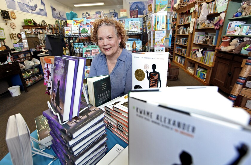 Once Upon A Time Books owner Maureen Palacios poses for a photo on Monday. The bookstore is getting an award from state Sen. Carol Liu next month.