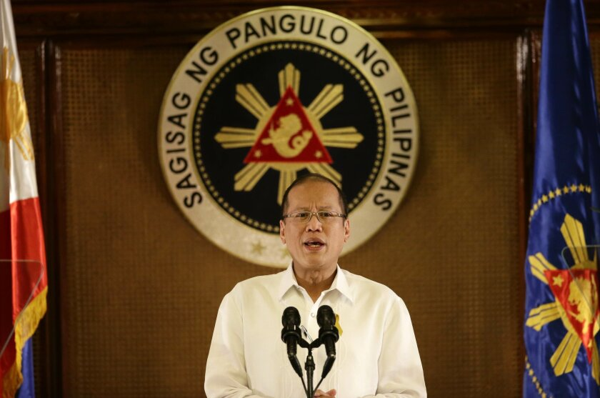 Philippine President Benigno Aquino III addresses the nation in a live broadcast from the Presidential Palace in Manila, Philippines Monday, July 14, 2014. The president defended the Government's position in the now controversial Disbursement Acceleration Program (DAP) or the alleged funding of programs by the government from its savings which was ruled as unconstitutional by the Philippine Supreme Court recently. (AP Photo/Bullit Marquez)