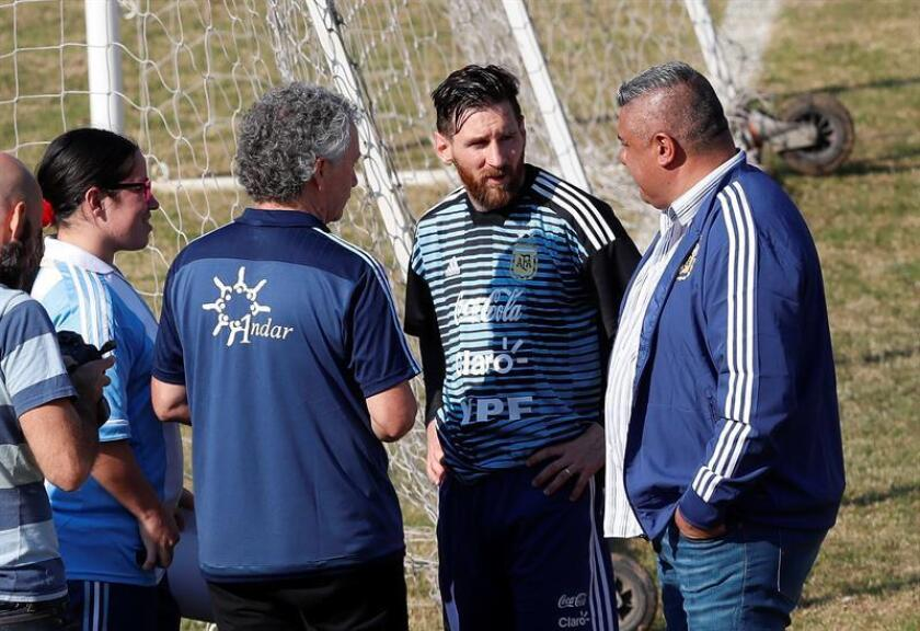 Argentine soccer player Lionel Messi (2L) with the president of the Argentine Soccer Association (AFA) Claudio Tapia May 27, 2018, at the Tomas Adolfo Duco stadium, in Buenos Aires (Argentina). EPA- EFE/David Fernández