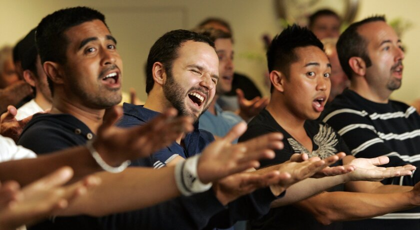 Yudi Andiwinata (left), Brandon Meredith and Ace Glorioso rehearse with the San Diego Gay Men's Chorus in Hillcrest. The group's upcoming concert honors several community organizations that serve the gay community.