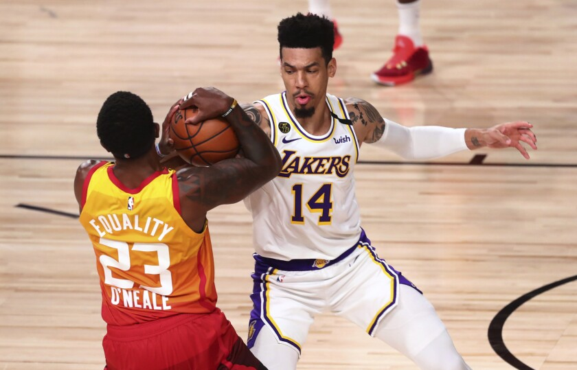 Utah Jazz forward Royce O'Neale holds the ball away from Lakers guard Danny Green during the second half.