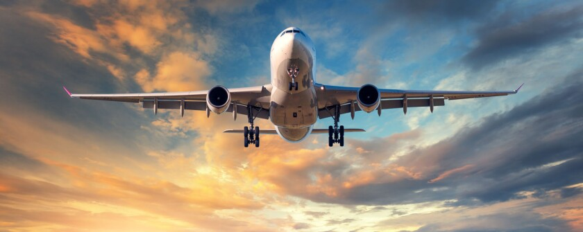 Landing airplane. Landscape with white passenger airplane is fly
