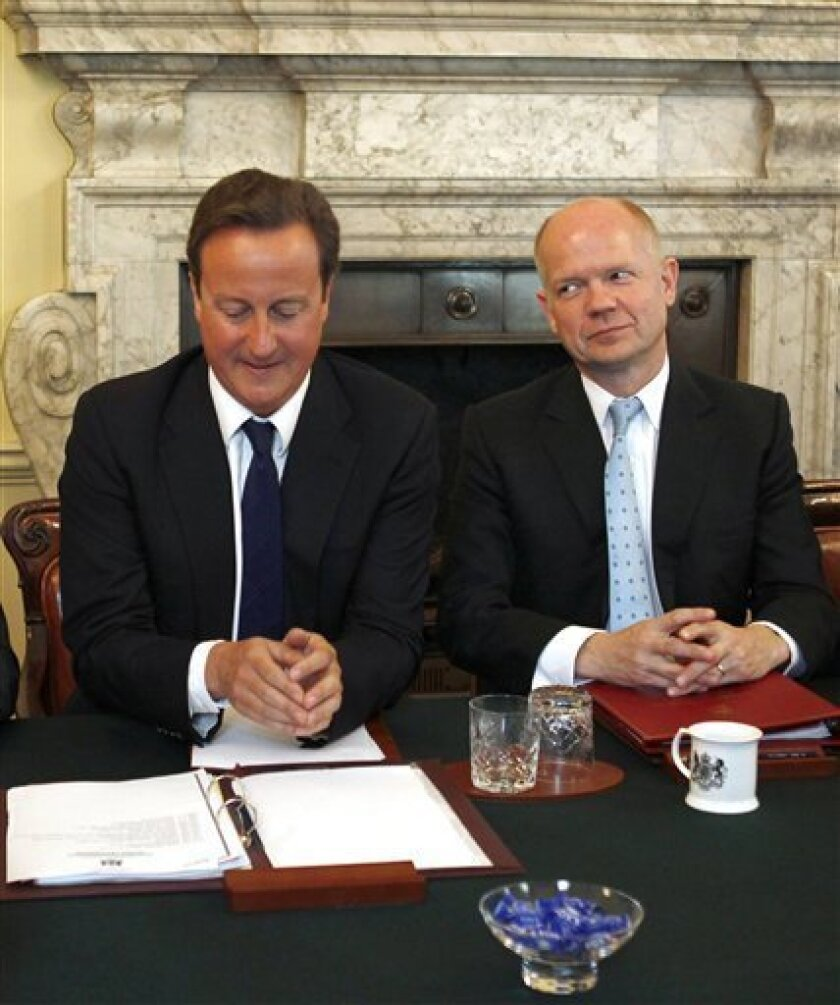 Britain's Prime Minister David Cameron, left, and Foreign secretary, William Hague, during a cabinet meeting at No.10 Downing Street, in central London, Tuesday, Sept. 7, 2010. (AP Photo/PA, Eddie Keogh)