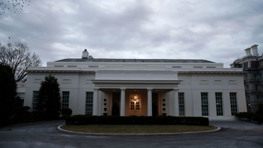 The West Wing of the White House is dark on Sunday.