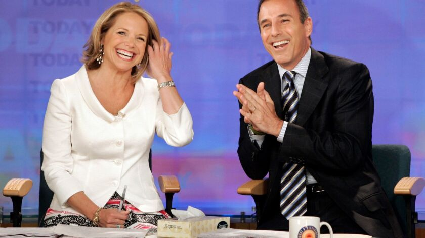 """FILE - In this May 31, 2006 file photo, Katie Couric and Matt Lauer, co-hosts of the NBC Today"""" prog"""