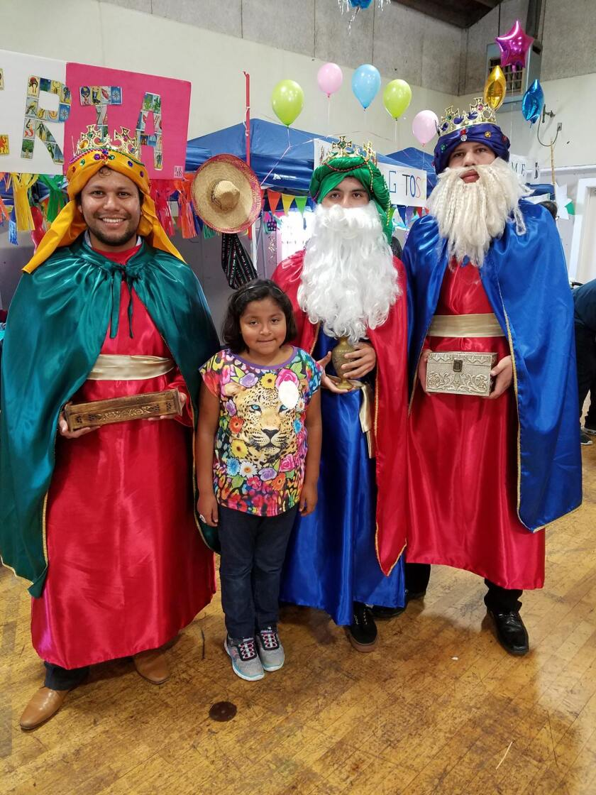 Volunteers at Casa Familiar's Annual Dia de Reyes Community Festival dress up in Three Kings costumes.