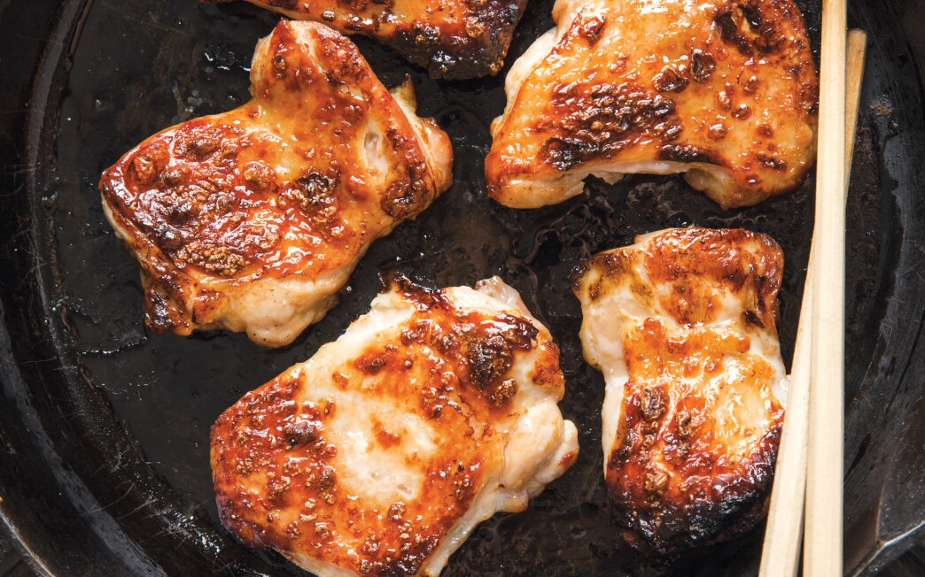Chicken is broiled to develop a smoky taste, then seasoned with ginger and soy.