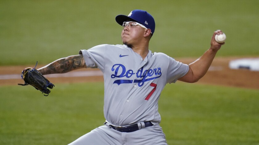 Los Angeles Dodgers' Julio Urias delivers to the San Diego Padres during the second inning in Game 3 of a baseball National League Division Series Thursday, Oct. 8, 2020, in Arlington, Texas. (AP Photo/Sue Ogrocki)