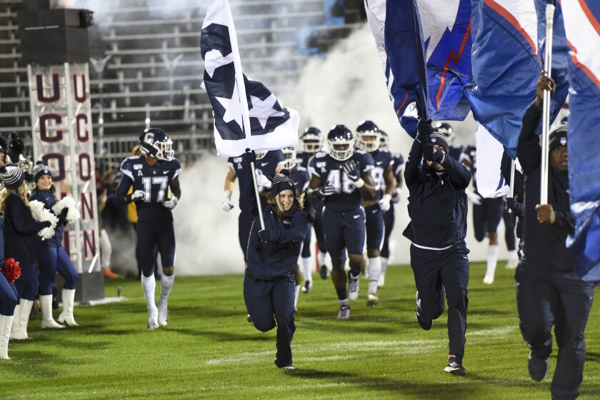 Connecticut takes the field before the start of a game against Navy on Nov. 1 in East Hartford, Conn.