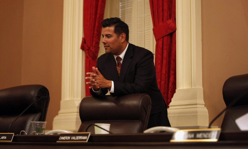 Sen. Ricardo Lara (D-Bell Gardens) rests on his chair during a break in a Senate Rules Committee meeting in Sacramento.