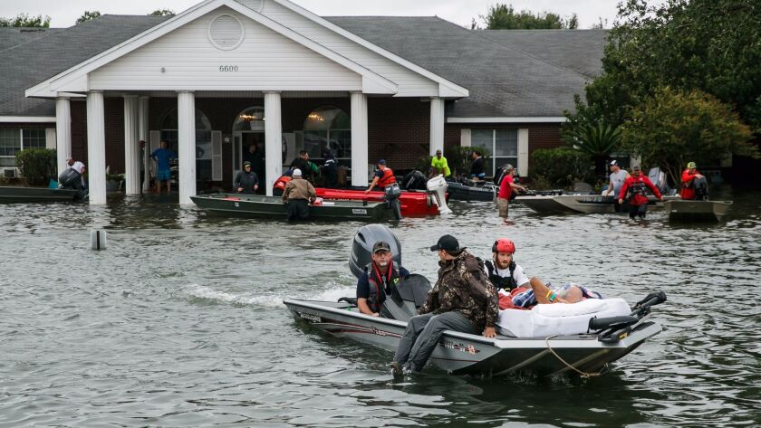 Volunteers rescue residents from the Cypress Glen nursing home