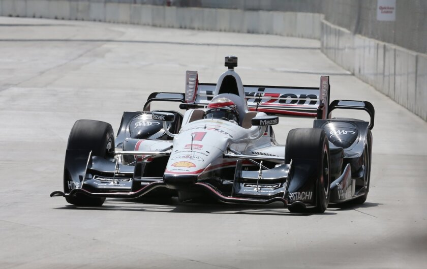 Will Power takes the first turn during qualifying for the first race of the IndyCar Detroit Grand Prix auto racing doubleheader Friday, May 29, 2015, in Detroit. Power secured the pole position. (AP Photo/Dave Frechette)