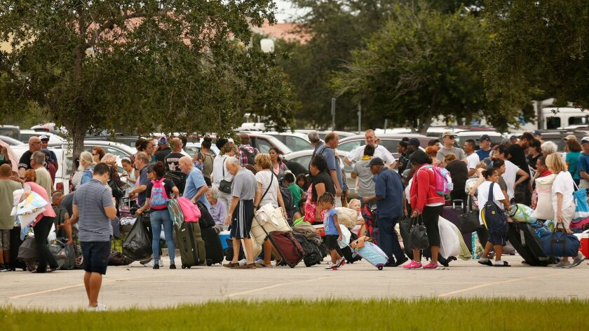 The Germain Arena in Estero, Fla., became an evacuation center where thousands of people flocked Sat