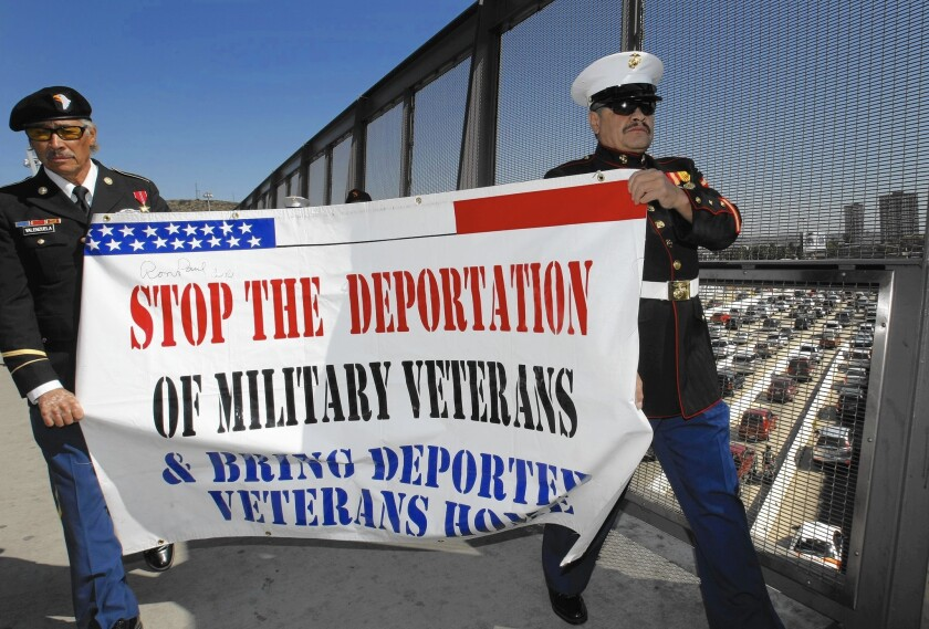 Former Army Sgt. Valente Valenzuela and former Marine Lance Cpl. Manuel Valenzuela, protest in San Ysidro, Calif. in 2012. Each served three years in the U.S. military before they were ordered deported.