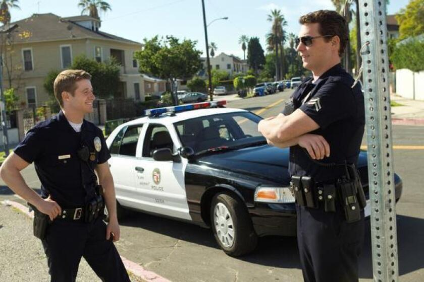 """Ben McKenzie and Shawn Hatosy in a scene from the TNT show """"Southland"""" shot on the streets of L.A."""