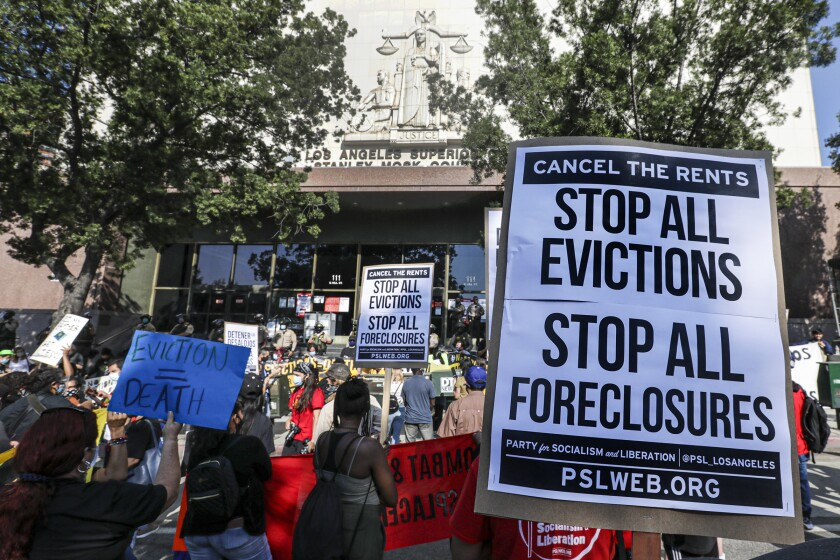 Housing rights advocates rally at L.A.'s Stanley Mosk Courthouse to protest eviction orders.
