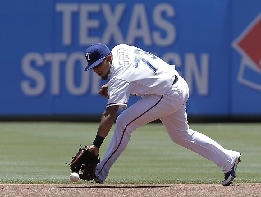 Texas Rangers second baseman Rougned Odor (73) fields a hit by Cleveland Indians' Michael Brantley during the first inning of a baseball game, Sunday, June 8, 2014, in Arlington, Texas. Odor would throw to first for the out. (AP Photo/Brandon Wade)