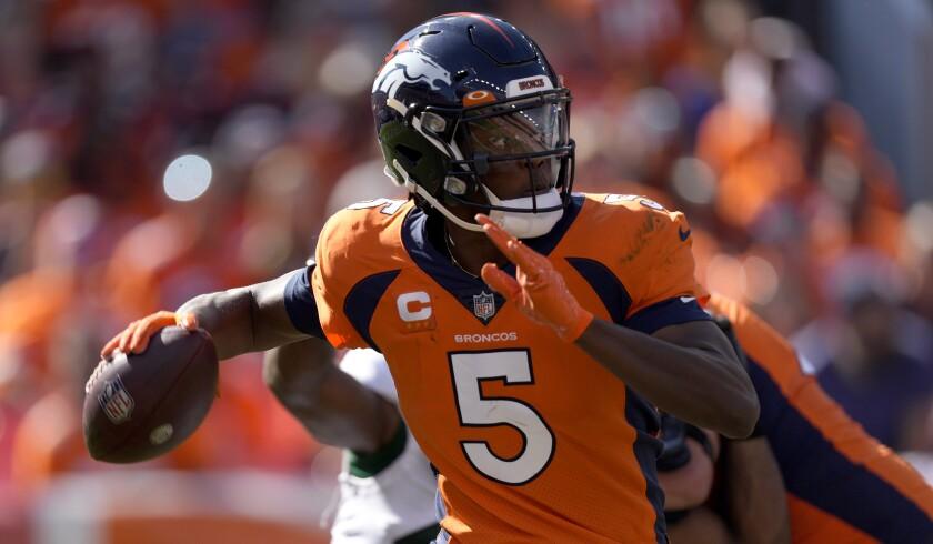 Denver Broncos quarterback Teddy Bridgewater (5) scrambles against the New York Jets.