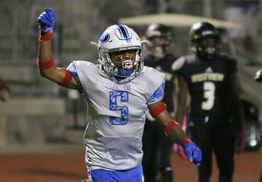 Rancho Bernardo's Ja'shon Williams celebrates his 14-yard touchdown run in the Broncos' 14-13 win over Westview.