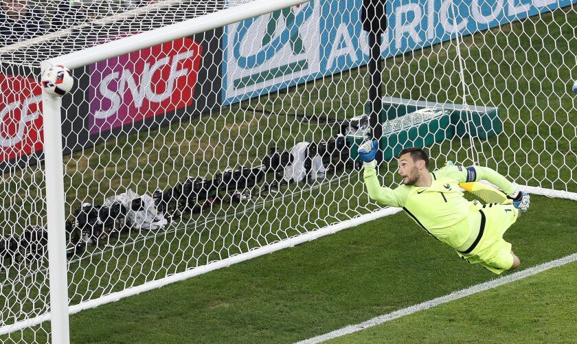 France goalkeeper Hugo Lloris watches as a shot from Germany's Joshua Kimmich hits the post during the Euro 2016 semifinal soccer match between Germany and France, at the Velodrome stadium in Marseille, France, Thursday, July 7, 2016. (AP Photo/Michael Sohn)