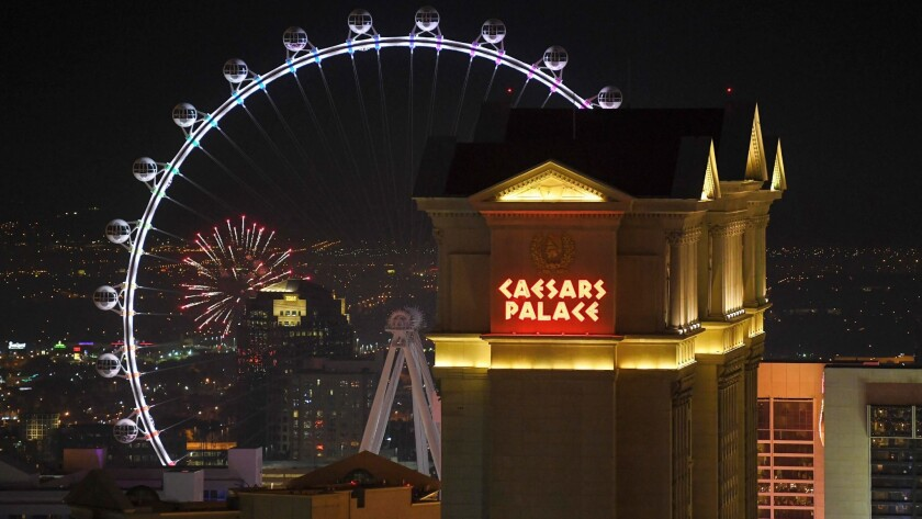 Amateur fireworks explode behind the High Roller and Caesars Palace Sunday, December 31, 2017. CRED