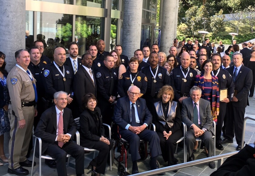 Joseph Sherwood, seated at center, is surrounded by his family and the investigators and first responders from the San Bernardino terror attack.