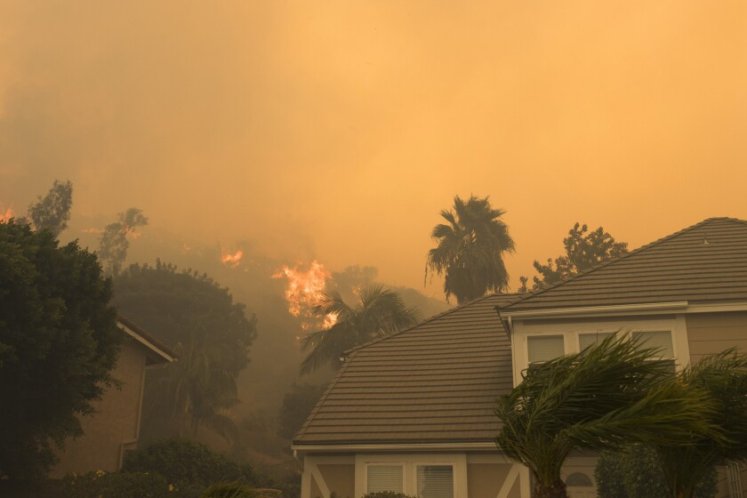 Fire burns in the Anaheim Hills area Monday morning.