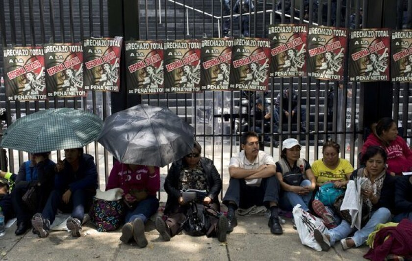 Teachers block access to the Mexican Senate in Mexico City on Thursday to protest education reform legislation.