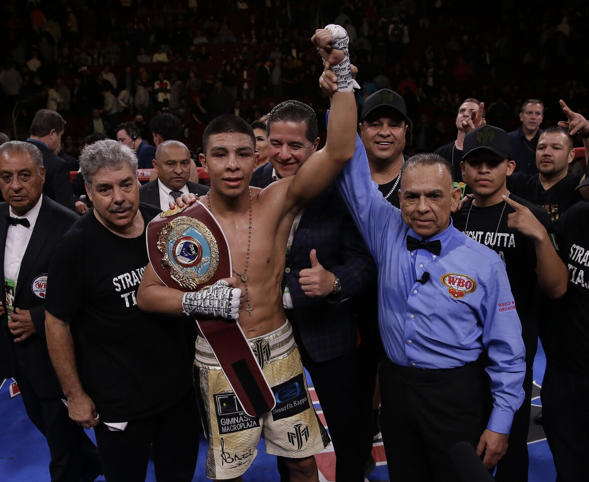 HOUSTON, TEXAS - JANUARY 26: Jaime Munguia celebrates his victory over Takeshi Inoue for the WBO Junior Middleweight championship at Toyota Center on January 26, 2019 in Houston, Texas. (Photo by Bob Levey/Getty Images) ** OUTS - ELSENT, FPG, CM - OUTS * NM, PH, VA if sourced by CT, LA or MoD **