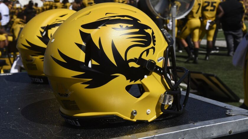 FILE - In this Sept. 22, 2018, file photo, a Missouri football helmet sits on the bench during the s