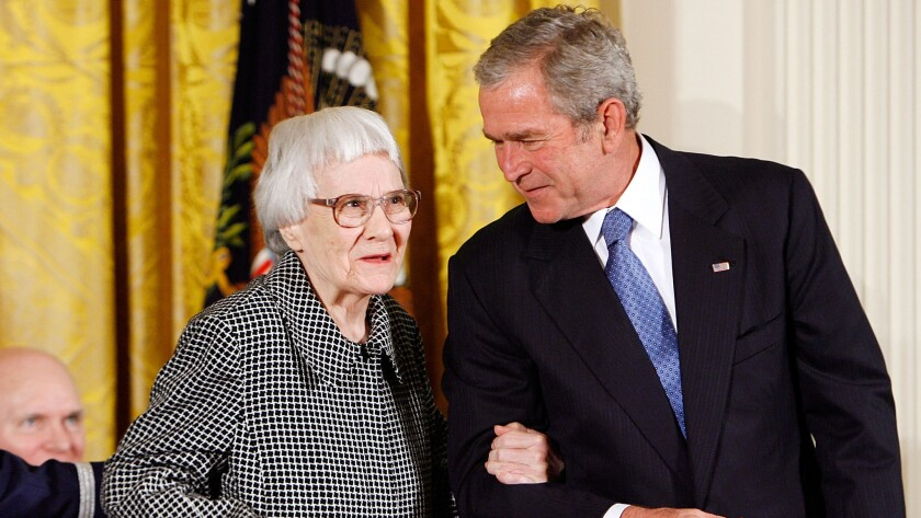 Harper Lee with President George W. Bush in 2007. Letters Lee wrote -- including one complainging about Donald Trump's casino -- are up for auction.