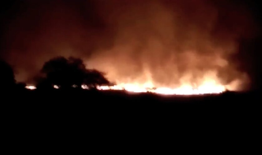 In this image made from video of K.K.Productions, a huge fire is seen at the Pulgaon ammunition depot in Pulgaon in the Indian state of Maharastra, Tuesday, May 31, 2016. A fire broke out at a major ammunitions depot in western India early Tuesday, causing fatalities, officials said.  (K.K. Product