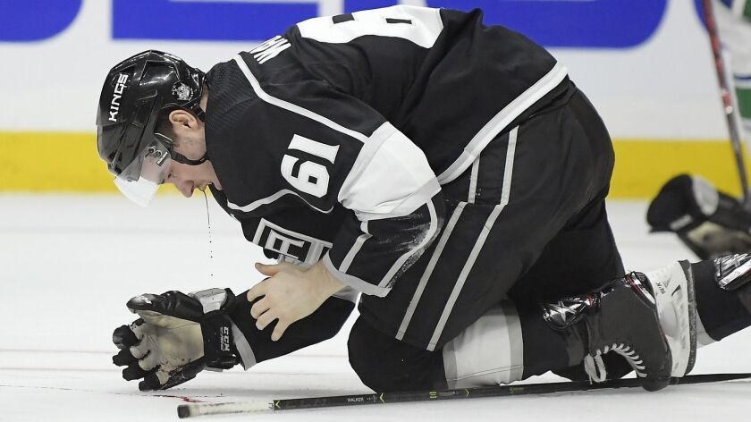 Kings defenseman Sean Walker bleeds onto the ice after taking a puck to the face against Vancouver on Feb. 14.
