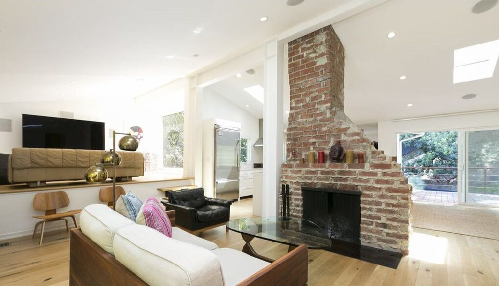 Remodeled during Leto's stay, the split-level home is anchored by a floor-to-ceiling brick fireplace.