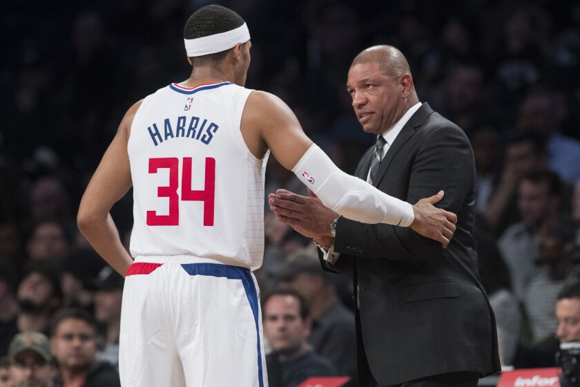 Los Angeles Clippers head coach Doc Rivers talks to forward Tobias Harris (34) during the second half of an NBA basketball game against the Brooklyn Nets, Saturday, Nov. 17, 2018, in New York. The Clippers won 127-119.