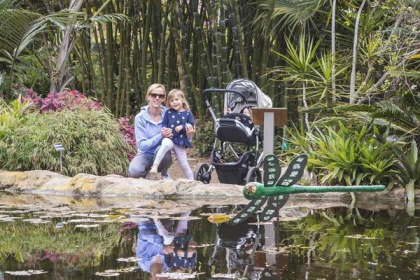 San Diego Botanic Gardens devotees Sarah Haayen, 4-year-old Kate, and baby Andrew seem to enjoy their time by the Bamboo Garden pond in Encinitas.