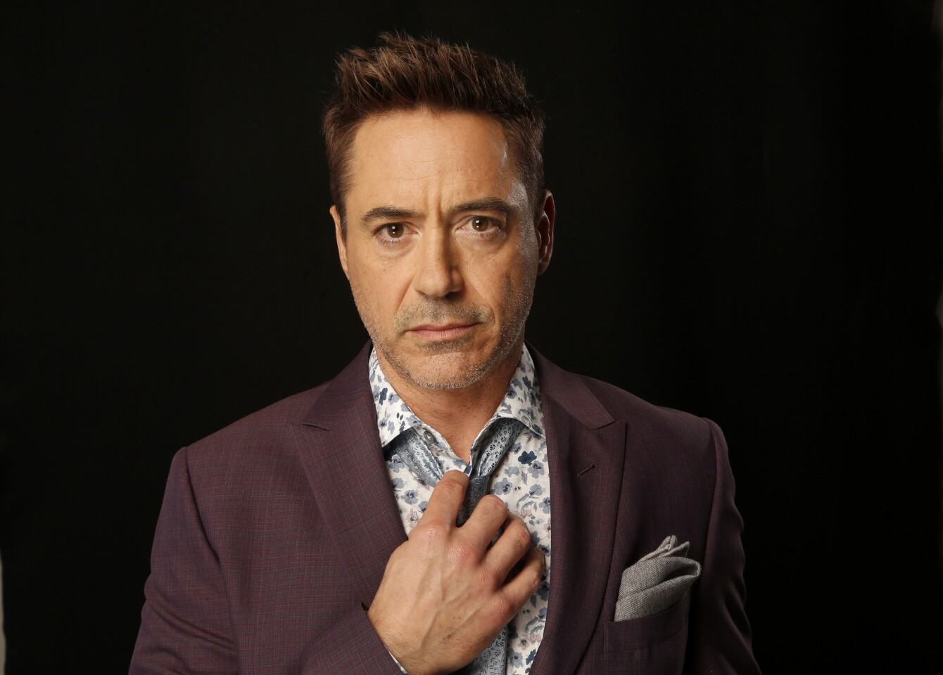 """Born in Manhattan on April 4, 1965, Downey is the son of underground filmmaker Robert Downey Sr. He made his film debut in his father's 1970 film, """"Pound,"""" when he was 5 years old."""