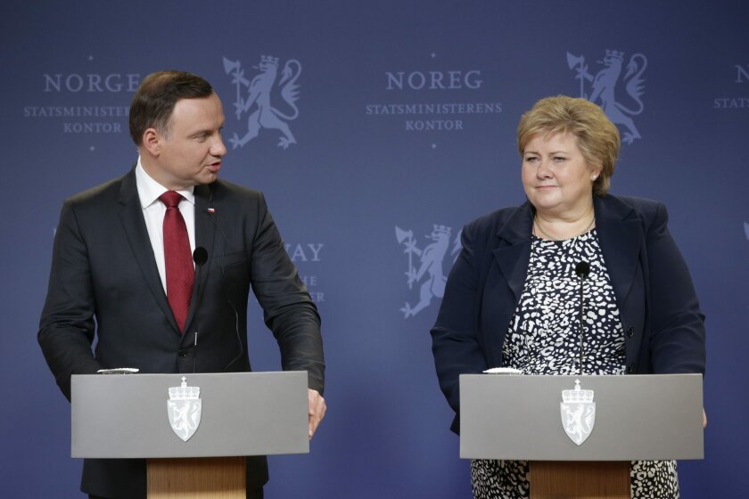 Norway's Prime Minister Erna Solberg, right, and Poland's President, Andrzej Duda, answer questions at a press meeting in Oslo, Norway, Monday May 23, 2016. (Hakon Mosvold Larsen/NTB scanpix via AP) NORWAY OUT