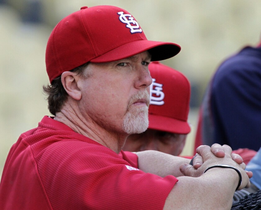 Dodgers batting coach Mark McGwire, shown with the St. Louis Cardinals in 2011, was named on just 16.9% of Hall of Fame ballots this year, far short of the 75% necessary for election.