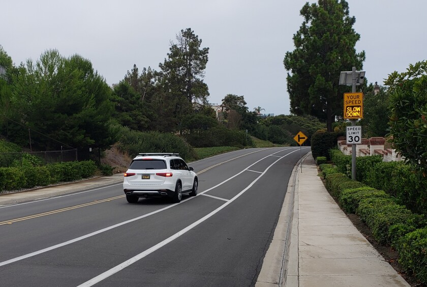 """A flashing speed indicator sign on Cardeno Drive flashes """"slow down"""" as a driver exceeds the speed limit."""