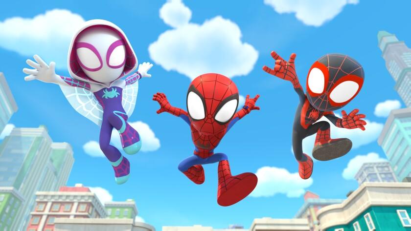 Three cartoon superheroes jump through the air.