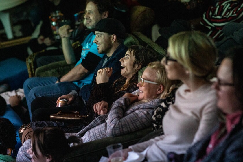 Zoe Bleu Sidel, center, Patricia Arquette and others watching a screening.
