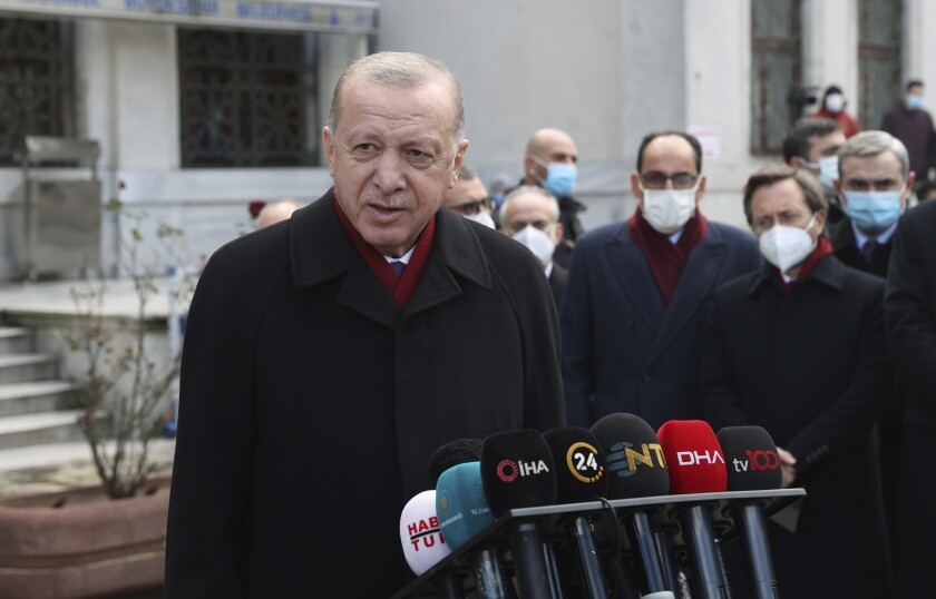 """Turkey's President Recep Tayyip Erdogan speaks to the media after Friday prayers, in Istanbul, Friday, Jan. 15, 2021. Turkey's president has criticized the United States for kicking his country out of the F-35 fighter jet program after Ankara purchased a Russian missile defense system. Speaking after Friday prayers in Istanbul, Turkish President Recep Tayyip Erdogan said Turkey paid """"very serious money"""" for the F-35 stealth jets and that America had committed """"a very serious mistake"""" with its NATO ally. (Turkish Presidency via AP, Pool)"""