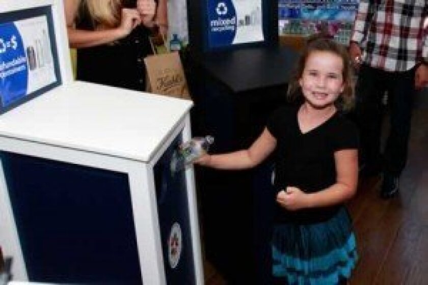 Juliana Melusky is one of the first students to recycle under the new bin labels program.