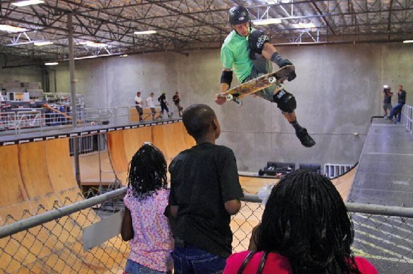 Tony Hawk performs for Jamarkus Poole (center), 12, in an event made possible by ESPN and the Make-A-Wish Foundation. (ESPN photo)