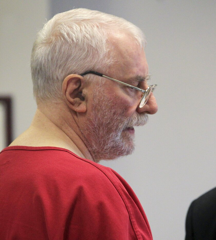 FILE - In this July 20, 2011 file photo, Jack McCullough turns to his attorney during a King County Superior Court hearing in Seattle. McCullough, a former police officer accused in the 1957 slaying of 7-year-old Maria Ridulph in Sycamore, Ill, agreed to return to Illinois to face charges after waiving his right to fight extradition. McCullough was later convicted and sentenced in 2012 to life prison. On Tuesday, March 29, 2016, McCullough is scheduled to appear in court in Sycamore where he could go free after a prosecutor found fault with the investigation and new evidence corroborated an alibi. (AP Photo/Elaine Thompson, File)