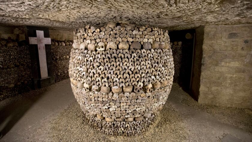 Skulls and bones stacked at the Catacombs in Paris, France.