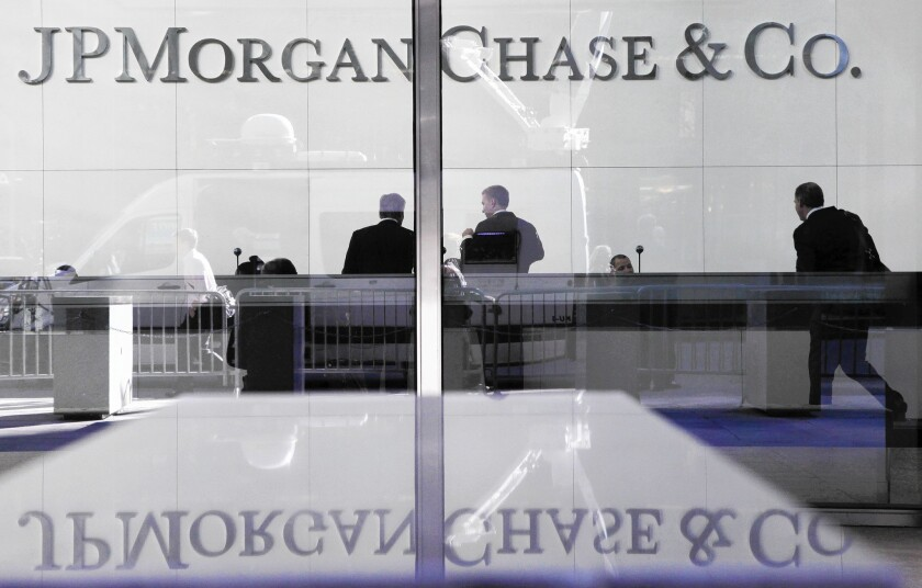 In a lawsuit against JPMorgan Chase, Los Angeles City Atty. Mike Feuer alleges that mortgage lenders swarmed into low-income minority neighborhoods with easy but deceptive offers of credit to people ill-equipped to handle the economic burden.