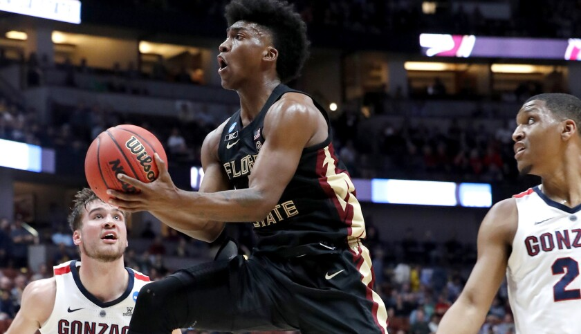 ANAHEIM, CALIF. - MAR. 28, 2019. Florida State guard Terance Mann drives to the basket against Gon
